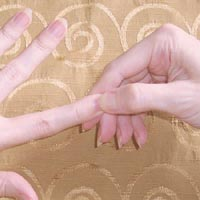 Hand reflexology: pinching fingertips.