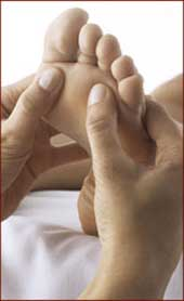 Foot reflexology massage.
